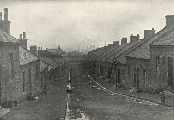 A deserted street of single-storey miners' cottages at Coatbridge, a mining and iron-producing area to the east of Glasgow. Date: circa 1936