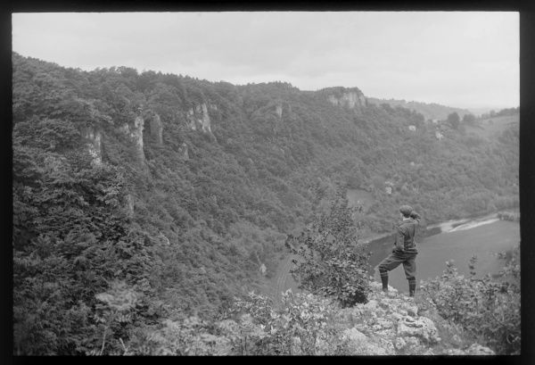 An Edwardian man stands admiring the Coldwell Rocks, near English Bicknor in the Wye Valley, Gloucestershire
