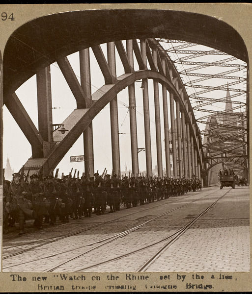 The new 'Watch on the Rhine' set by the Allies: British troops crossing Cologne Bridge
