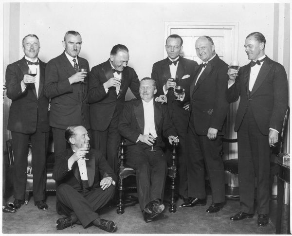Air Marshal William Avery Bishop (1894 - 1956) VC, Canadian First World War flying ace, being toasted at a gathering of air aces in Berlin where he was guest of honour