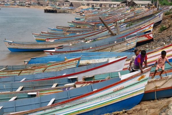 Colourful fishing boats lined up on the shore at Vishinjam, Trivandrum, Kerala State, India