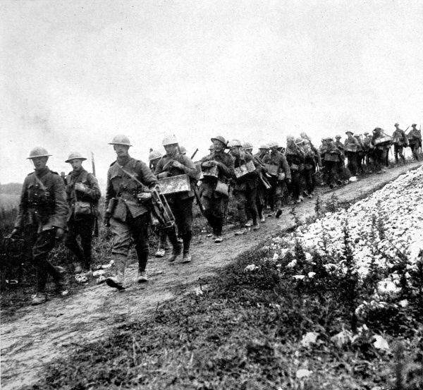 British grenadiers, armed with what the caption described as 'the most deadly weapon of this murderous war,' marching towards the front lines in July 1916