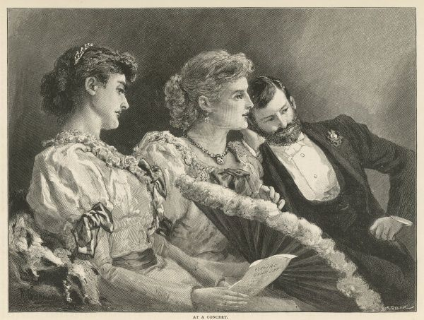 Two women and a gentleman, all dressed in their best evening attire, watch a performance intently with admiring glances from all three