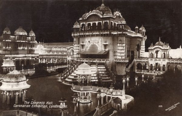 View by night of the Congress Hall at the Coronation Exhibition, held at White City, West London, to celebrate the coronation of King George V. Date: 1911