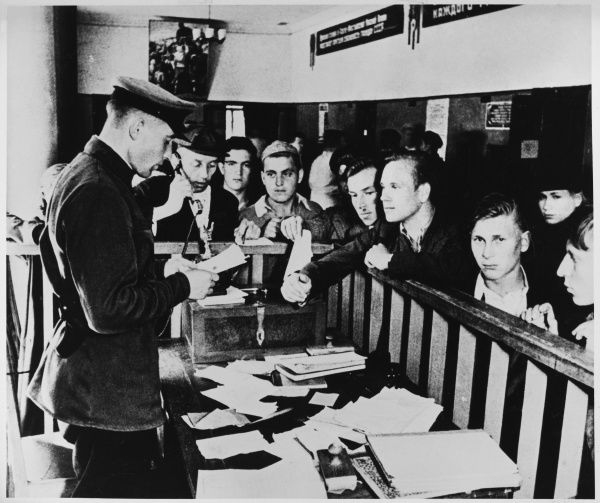 Young men register to join the Russian army. Conscription was introduced on 23 June 1941