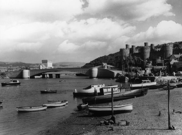 Conway (Conwy) Castle, the most magificent of English King Edward I's fortresses, in Gwynedd, North Wales. Here we see the harbour and 'new' bridge (built 1958). Date: 13th century