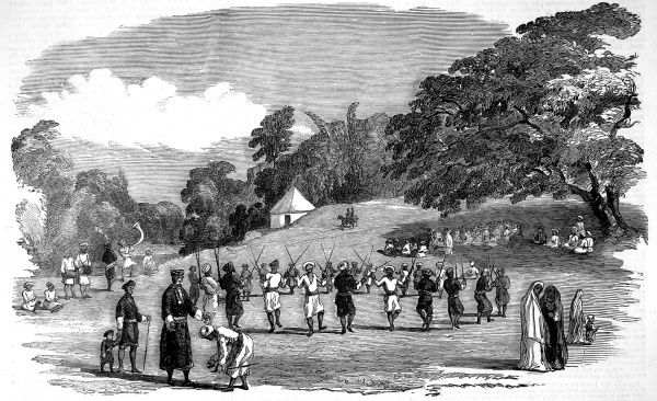 Engraving showing the Coorg Harvest Festival held in Madras, India, 1852. This festival was an annual event held just prior to the farmers gathering the harvest. This image showing a traditional dance with each of the male dancers holding two sticks