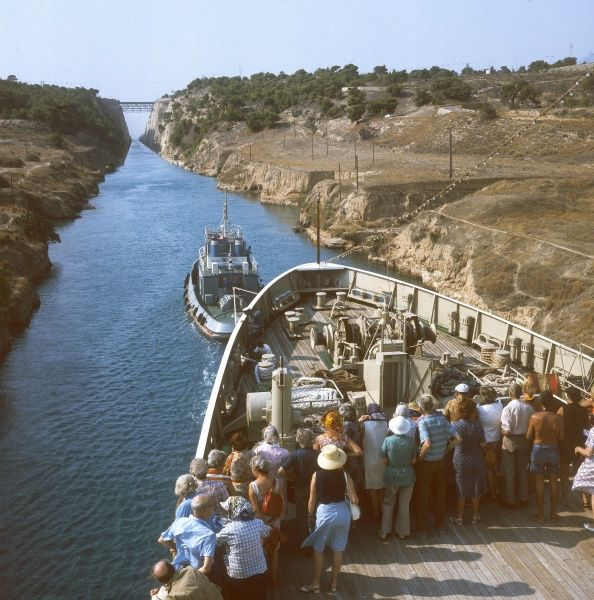 Passing from West to East on the Corinth Canal, which connects the Gulf of Corinth with the Saronic Gulf in the Aegean Sea, Greece. Date: built 1881 - 1893