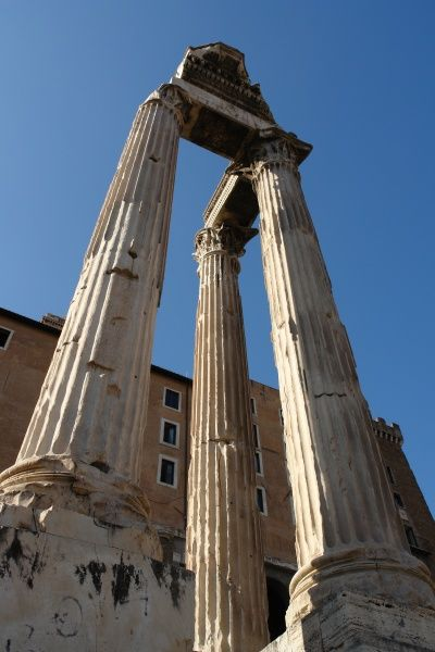 Three Corinthian pillars in the Roman Forum, or Forum Romanum, Rome, Italy