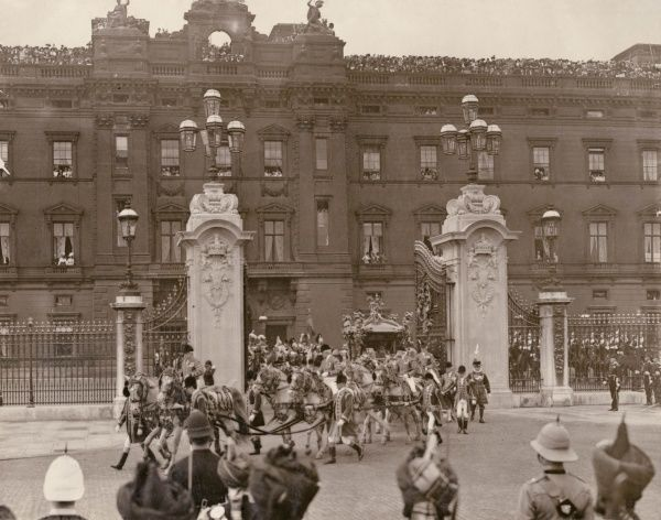 The Coronation Procession leaving Buckingham Palace, with King George V and Queen Mary in the coach