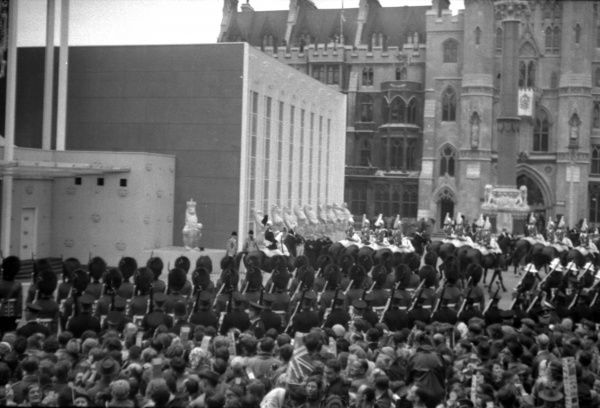 the Queen Mother's escort mounted by the Household Cavalry moves off down Victoria Street