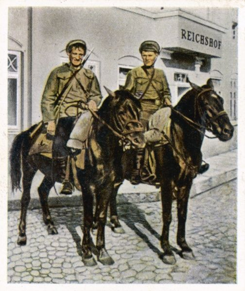 RUSSIAN POLISH WAR Red army Cossacks pose on horses in front of the headquarters at Soldau, during fighting against nationalists