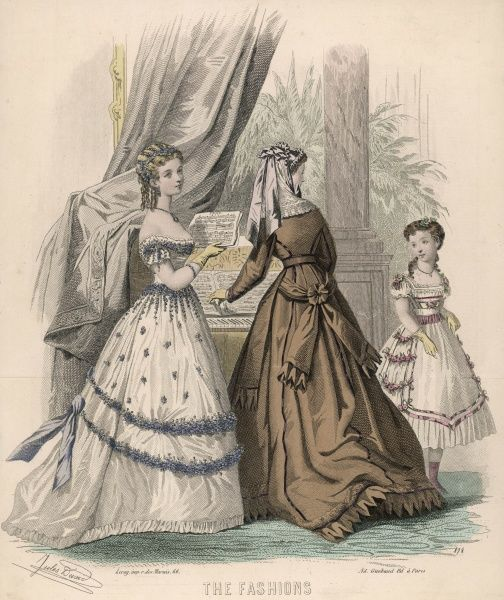 A brown dress with the fullness of the skirt pulled behind by an attached sash. White, flower trimmed dresses, one with a train the other with an apron front