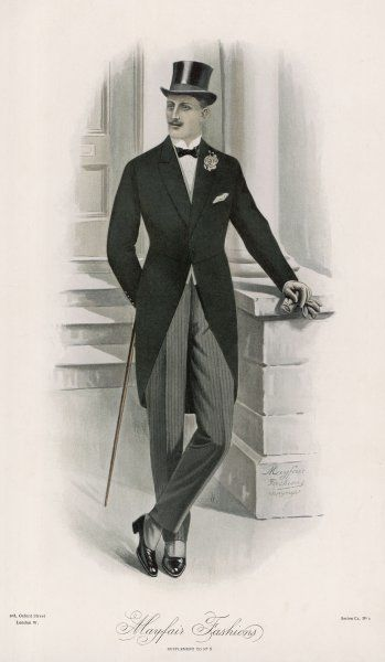 A gentleman wearing the Season's MORNING COAT with floral buttonhole, top hat, grey striped narrow fitting trousers with a front crease, spats, wing collar & bowtie