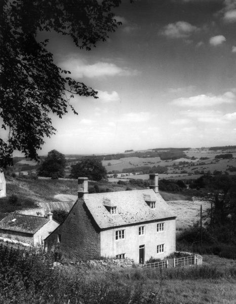 Goldwell Farm, a typical Cotswold farm, in the countryside near Charlton Abbots, Gloucestershire, England. Date: 19th century