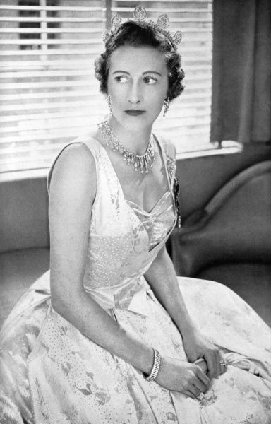 The Countess of Leicester, previously Lady Elizabeth Yorke (1912 - 1985), who acted as Lady of the Bedchamber to Queen Elizabeth II at her Coronation, pictured wearing the Norman Hartnell dress she wore on the occasion. Designed by Norman Hartnell