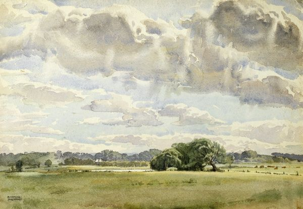 A flat country landscape with a big sky