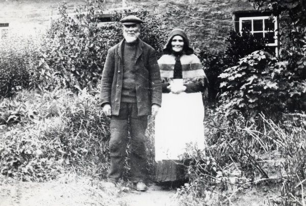 A middle aged couple outside their cottage in Pembrokeshire, South Wales