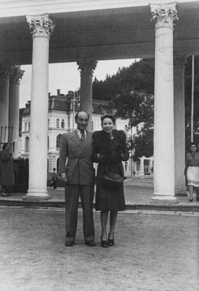 A couple pose for their photograph in the spa town of Marianske Lazne, Czechoslovakia. Behind them is the famous colonnade with its corinthian columns