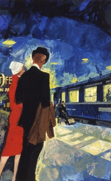 A couple at a French station, about to board a train. A porter loads luggage in the background