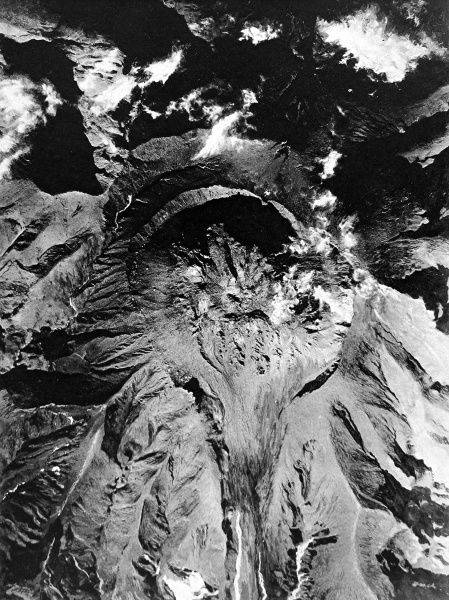 Photograph showing an aerial view of Mont Pelee, Martinique, the volcano that erupted and destroyed St. Pierre in May 1902. Viewed from an airplane at 8000 ft, the hardened lava stream can be seen stretching away to the bottom of the image