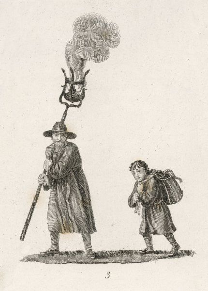 Two men walking through the night carry a flaming cresset - a basket on a pole, containing flammable material - to show them where they are going