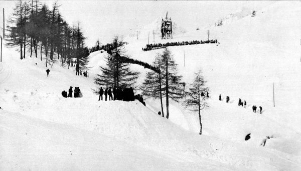 Photograph showing the Cresta Run, with its 'Crow's Nest' and grandstand (top) on a St. Moritz race day in 1912. This famous course is the home venue for the St. Moritz Tobogganing Club and was first laid out in 1884