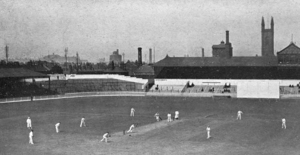 A view of the Bramall Lane cricket ground, Sheffield. In progress is a three day Test Trial match (1st to 3rd June) between G.L.Jessop's XI and P.F.Warner's XI, ultimately won by the former. Bramall Lane ground served as both cricket