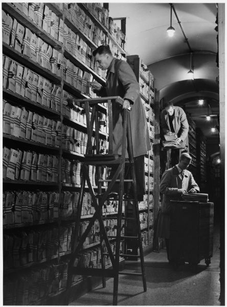 Researching records in the New Scotland Yard Criminal Record Office storage files. Metropolitan Police