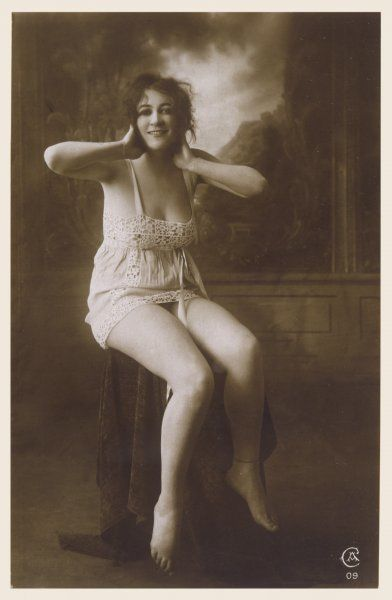 A young woman poses provocatively in a chemise with a crochet yoke, hem & insertions