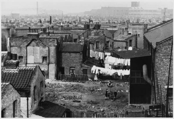 A landscape of working class homes in London, with a handy patch of waste ground where the wives can hang up their washing and the kids can play among the stones and refuse