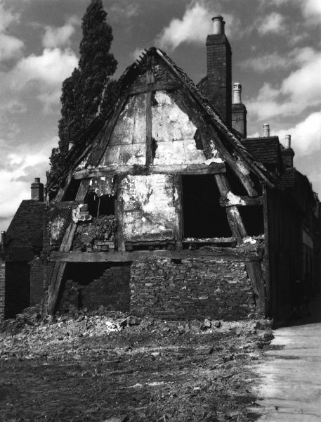 A derelict cruck-beam house (being demolished), at Lichfield, Staffordshire, England. This was one of the very earliest forms of building construction. Date: 19th century