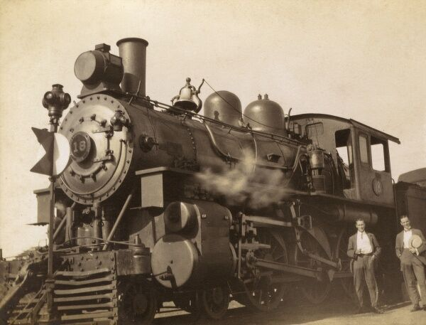Cuba - Locomtovie of the train service which ran between Havana and Santiago de Cuba, pictured at Zaza del Medio, a stop along the line. Date: 1913