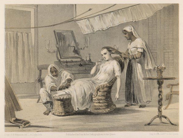 The magistrate's wife is attended to by her servants - one brushes her hair