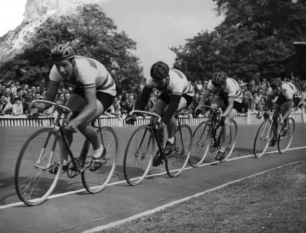 A cycle racing event, watched by a crowd of spectators.  circa 1940s