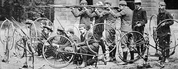 Photograph of the Cyclist Company of the 1st Oxford University Volunteers, practising their drill for resisting an attack by cavalry, 1889
