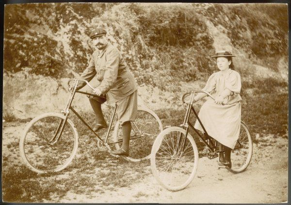 Father and daughter set off on their bicycles - she a little apprehensively