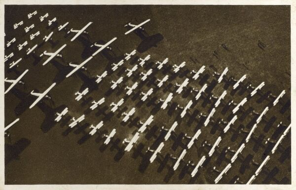 An airfield, crammed with the planes of the Czech Airforce. Date: circa 1920s