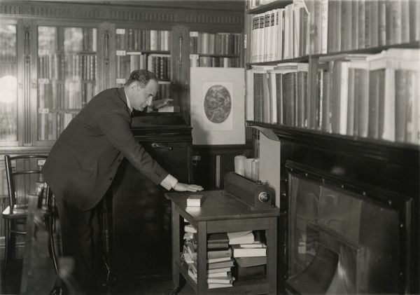 "Photograph of the Czechoslovak vaudeville telepath Fred Marion (a.k.a. Josef Kraus), 1933. Kraus is making a ""trial"" of a tin box as to whether it contains a hidden object. HPG/1/7/15 (i)&quot"
