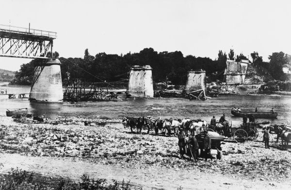 German troops on the banks of the River Prut at Czernowitz (modern day Chernivtsi in western Ukraine). The bridge in the background was blown up by retreating Russians before the Germans captured the city on 3 August 1917