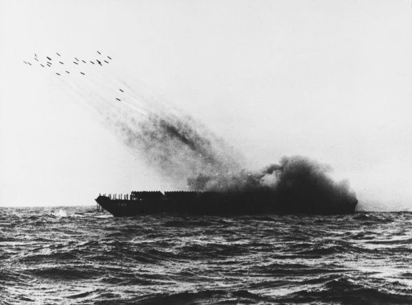 A converted landing craft fires rockets to support the landing allied troops. D-Day began on June 6th, 1944 at 6:30am and was conducted in two assault phases - the air assault landing of allied troops followed by an amphibious assault by infantry