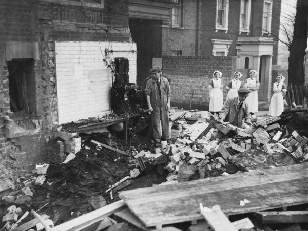 The Porter's Lodge of a London Hospital wrecked by a German raider's bomb. Nobody was seriously hurt - circa late 1940