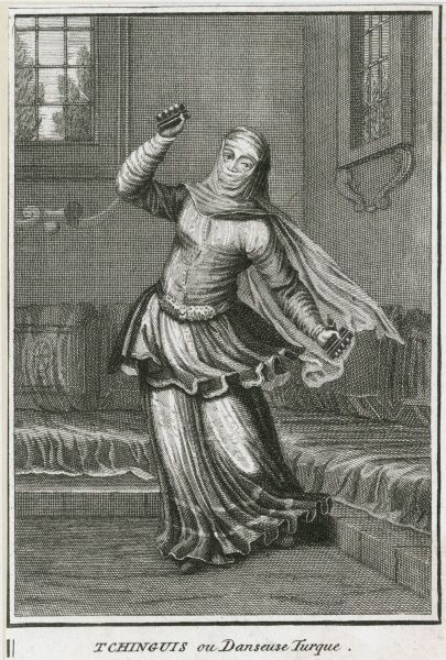 A veiled woman dancing