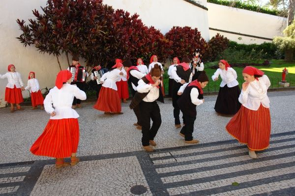 Dancers belonging to a folklore group from Campanario, performing an old dance in the street in Funchal, the capital city of Madeira