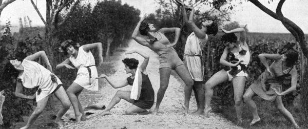 A group of German female dancers strike a very modern pose as they use their artistry to celebrate the end of the wine harvest on the Rhine. Date: 1930