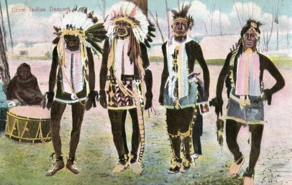 Dancers of the Crow Tribe performing a ceremonial dance. Date: 1911