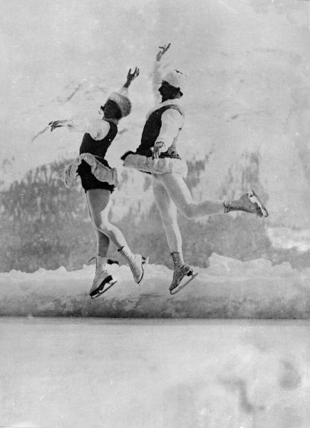 A man and woman in matching outfits, dancing on skis! Date: early 1930s