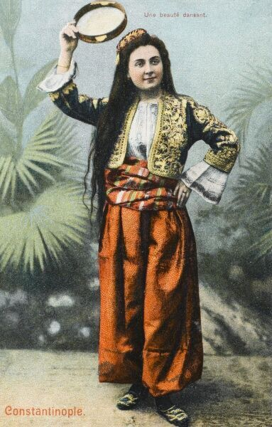 A beautiful young dancing girl from Constantinople, Turkey, holding a tamborine