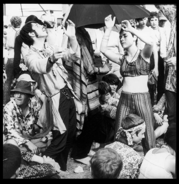 "Hippies getting high and dancing together at a rock festival at Woburn Park, Bedfordshire, England, during the original ""Summer of Love&quot"