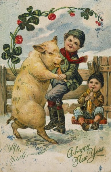 A boy dances with a pig while his friend provides the music